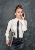 Business woman with laptop and mobile phone Stock Photography