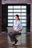 Business woman laptop in modern lobby Royalty Free Stock Photos