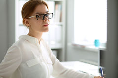 Business woman with laptop in the office Stock Photography