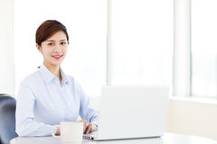 Business woman with laptop in the office. Young  business woman with laptop in the office Royalty Free Stock Photos