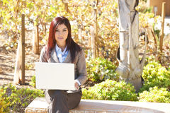 Business woman on laptop out of office Royalty Free Stock Images