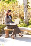 Business woman on laptop out of office Royalty Free Stock Photography
