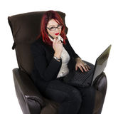 Business woman with laptop and a pen Stock Photography
