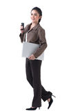 Business woman with laptop and phone Royalty Free Stock Image