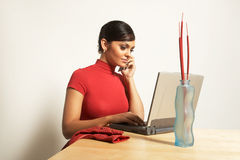 Business woman with laptop and phone Royalty Free Stock Images