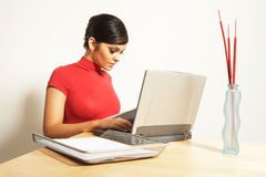 Business woman with laptop and phone Royalty Free Stock Photo