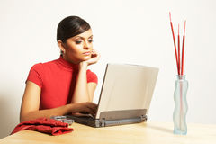 Business woman with laptop and phone Stock Image