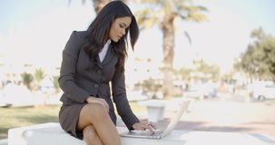 Business Woman With Laptop Sitting On The Bench Stock Photography