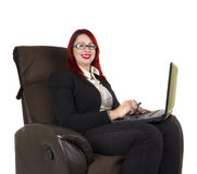 Business woman with laptop. Business woman sitting on the couch with her laptop. White background Royalty Free Stock Photography