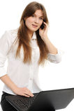 Business woman with laptop speaks via phone Stock Photo