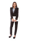 Business woman with laptop standing in full length Stock Image