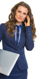 Business woman with laptop talking cell phone Stock Photo