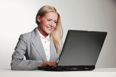 Business woman with laptop Royalty Free Stock Photos