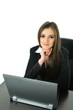 Business Woman with Laptop. Business woman working on her laptop at her desk Royalty Free Stock Images