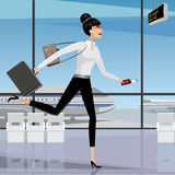 Business woman late for the plane Royalty Free Stock Photo