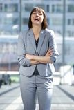Business woman laughing with arms crossed Stock Photos