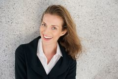 Business woman laughing with black jacket and white shirt Royalty Free Stock Photos
