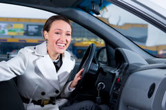 Business woman is laughing in car Stock Photography