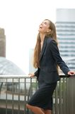 Business woman laughing in the city Stock Photos