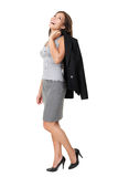 Business woman laughing full length. Business woman laughing standing isolated on white background in full length. Beautiful joyful happy mixed race Chinese Stock Photo