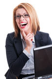 Business woman laughing hard. While holding a laptop Stock Image