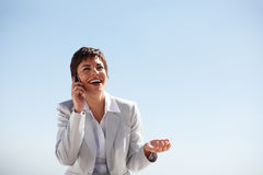 Business woman laughing over a conversation Royalty Free Stock Photos