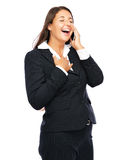 Business woman laughing on phone Royalty Free Stock Photos