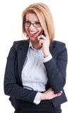 Business woman laughing while talking on the phone. Blonde and sexy business woman laughing while talking on the phone Royalty Free Stock Photo