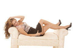 Business woman lay on bench smile Stock Photography
