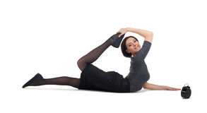 Business woman lay in yoga pose with clock Royalty Free Stock Image