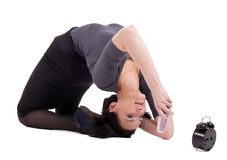 Business woman lay in yoga pose talk on cell Stock Photo