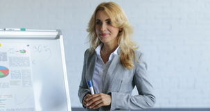 Business Woman Leading Presentation While Businesspeople Group Listening And Asking Questions, Communication On