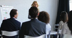 Business Woman Leading Presentation While Businesspeople Group Listening And Asking Questions, Communication On stock video