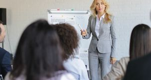Business Woman Leading Presentation While Businesspeople Group Listening And Asking Questions, Communication On stock footage