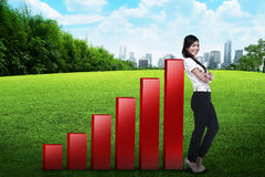 Business woman lean on graph Stock Photo