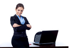 Business woman leaning against her desk Royalty Free Stock Image