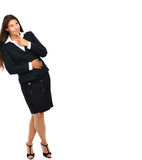 Business woman leaning against wall Royalty Free Stock Photos