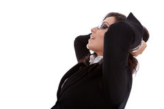Business woman leaning backon chair. A business woman leaning back in a black chair dreaming, side view Stock Photo