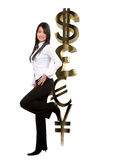 Business woman leaning on currency symbols Royalty Free Stock Photo
