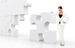 Business woman leaning on a puzzle Stock Images