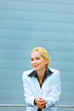 Business woman leaning on railing at building Stock Photos