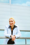 Business woman leaning on railing at office Stock Images