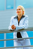 Business woman leaning on railing at office Stock Photos