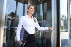 Business Woman Leaving Building stock images