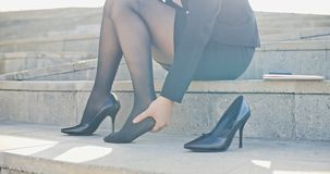 Business woman feel foot pain. Business woman with leg cramps and ankles pain from high heels royalty free stock photos