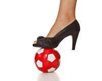 Business woman leg in high heel with soccer ball Stock Photos