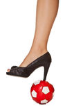 Business woman leg in high heel with soccer ball Royalty Free Stock Photography