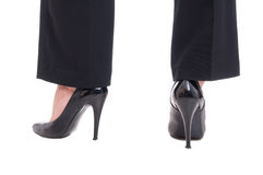 Business woman legs wearing black leather shoes with high heels stock photos