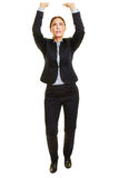 Business woman lifting imaginary object Stock Image