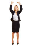 Business woman lifting imaginary object up stock image